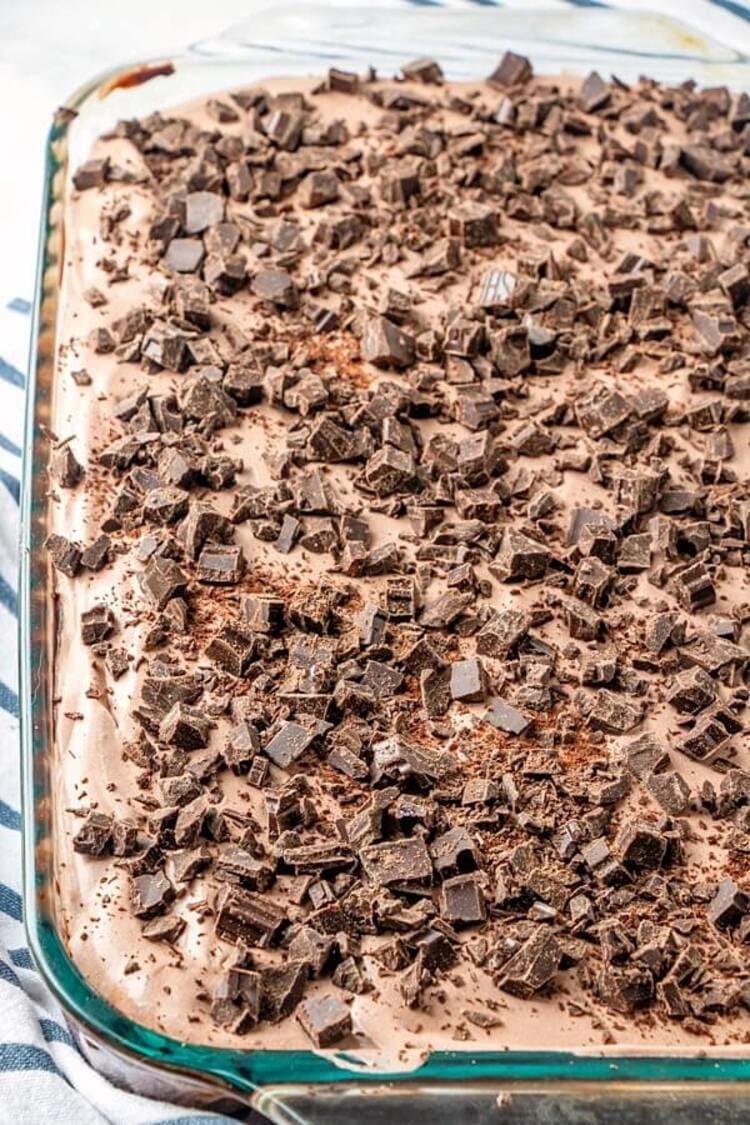 Chocolate Pudding Poke Cake filling a 9x13 baking pan
