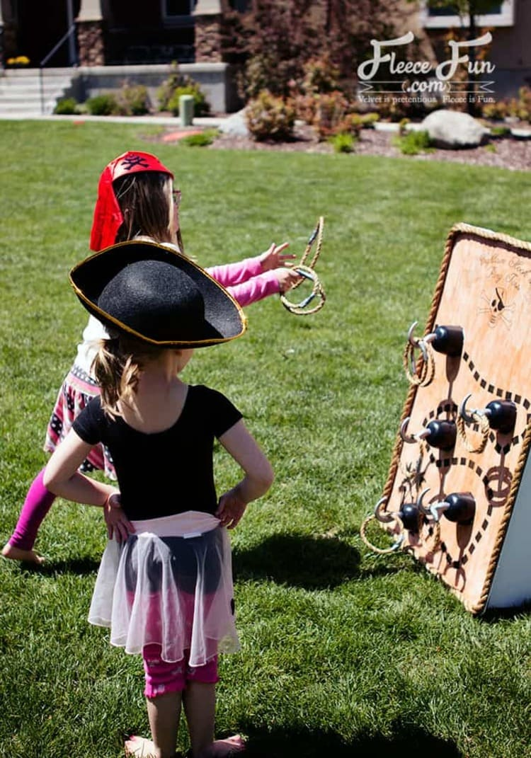 Captain Hook Ring Toss Pirate Party Activity With Two Kids Tossing Rings On The Board