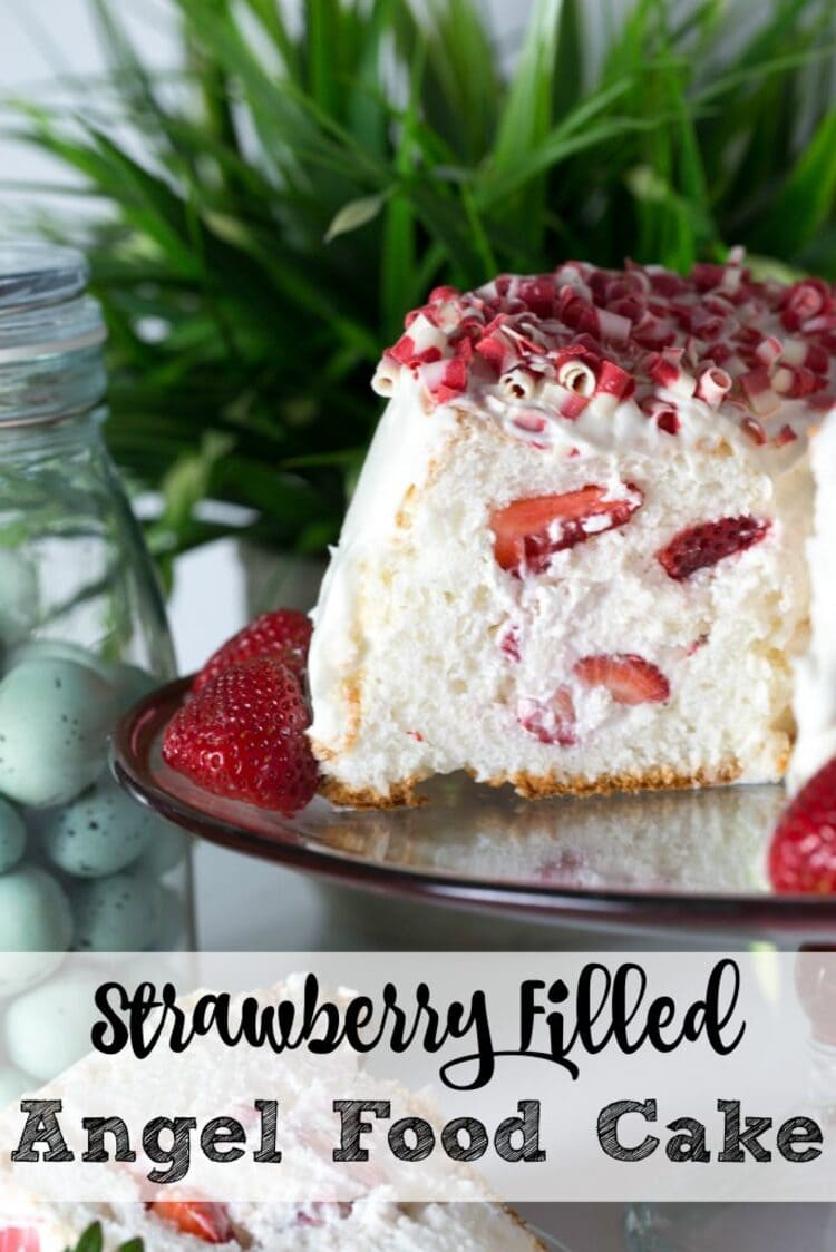 strawberry filled angel food cake cut in half and laid on a plate