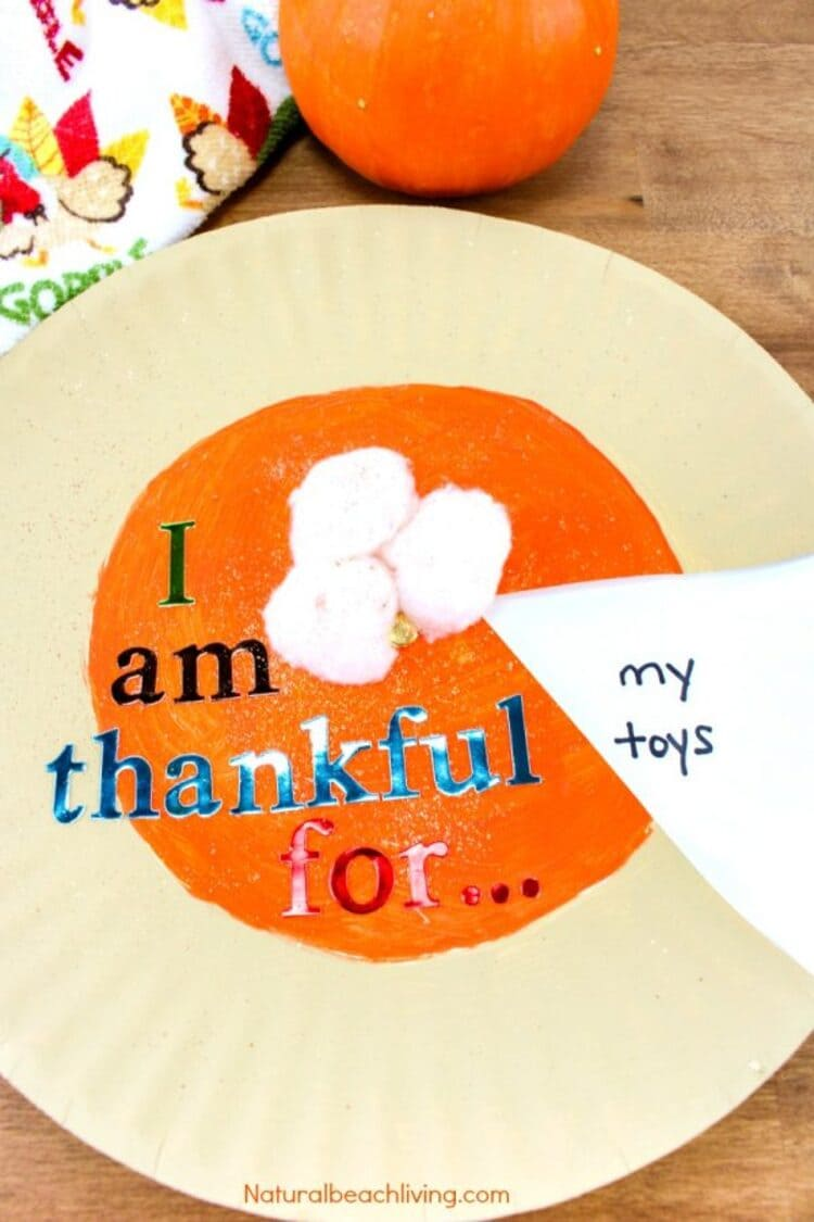 paper plate craft thanksgiving plate on a wooden surface