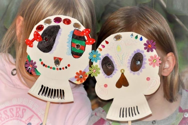 paper plate craft skull masks wearing by two kids