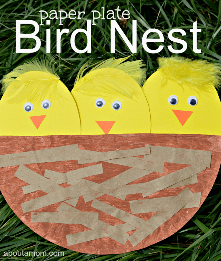 paper plate craft yellow birds in a brown nest on a black background